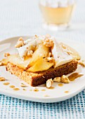 Honey cake with sautéed pears and walnuts