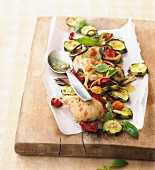 Chicken breasts with roast vegetables and basil