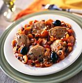 Noisette fillet of pork with carrots and black olives