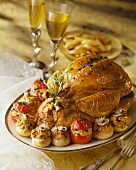 Roasted capon with truffles,tomatoes and stuffed onions