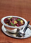 Doe stewed in red wine with raisins and zucchinis