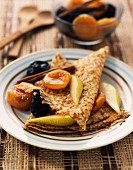 Pancakes with warm stewed dried fruit