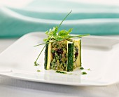 Cube of zucchini with chopped green vegetables