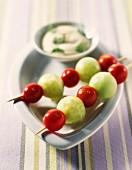 Cucumber balls and cherry tomato brochettes with dip