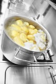 Potatoes boiling in water