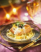 Thick piece of salmon with truffles and creamy tagliatelles