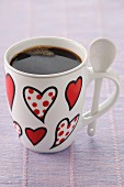 Cup of coffee decorated with hearts