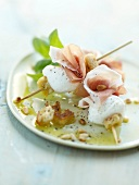 Raw ham,mozzarella and crouton mini skewers