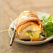 Rolled pork fillet garnished with ham and Comté cheese