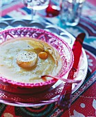 Artichoke and pumpkin soup with scallops
