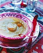 Artichoke and pumpkin soup with scallops