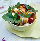 Colourful lasagnelle pasta with cherry tomatoes and basil