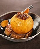 Baked apple stuffed with dried fruit