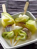 Herring,apples in oil and green apple skewers