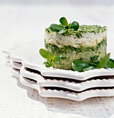 Fish purée and courgette timbale with rocket pesto