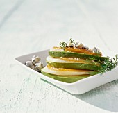 A stack of avocado, pear, Roquefort and spearfish slices