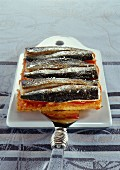Puff pastry tart with sardines and tomatoes