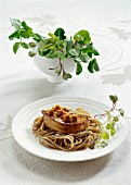 Fried foie gras slices, soba noodles, soy sauce and chestnuts