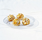 Fresh goat's cheese balls coated with dried fruit