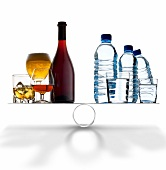 Alcoholic drinks against water on scales