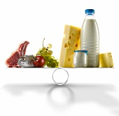 Selection of fresh products against dairy products on scales