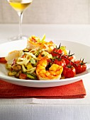 Sauteed gambas with linguine and summer vegetables