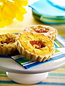 Baked egg custard and pine nut tartlets