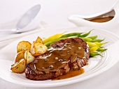 Steak with pepper sauce ,beans and potatoes