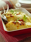 Cheese-topped Quenelle dish