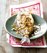 Grilled sea bream with onions