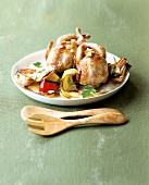 Roast quail with pine nuts and onions