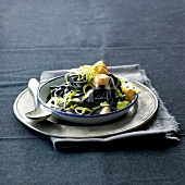 Squid ink tagliatelles with scallops