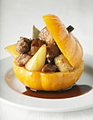 Lamb collar with old-fashioned vegetables served in a small pumpkin
