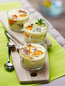 Selection of cheese and ham coddled eggs