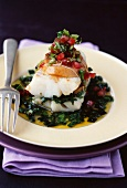 Cod burger with spinach, chopped tomatoes and confit lemon
