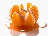Peeled open clementine with juice