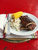 Grilled spare ribs with corn and potato salad