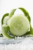 Peeling a cucumber