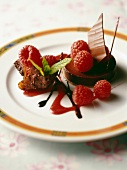 Tin pastry chocolate tart with raspberries and Beaujolais sauce