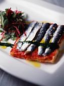 Marinated sardine and tomato tartlet