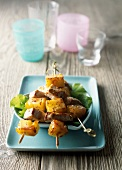 Caramelized pork and pineapple kebabs with sesame seeds