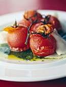 Bunch of roast tomatoes with balsamic vinegar, olive oil and mozzarella
