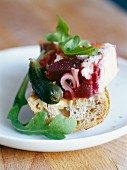Chicken and beetroot terrine on a piece of bread