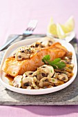 Piece of salmon with button mushrooms
