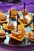 Nougatine tuile biscuits with pan-fried Foie-gras cubes