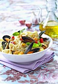 Farfalles with mussels flambeed with Pastis, gorgonzola and mascarpone sauce