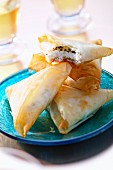 Goat's cheese, thyme and honey filo pastry triangles