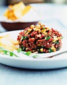 Beef tartare with crushed walnuts