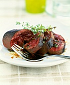 Heart of ostrich cooked rare with old wine vinegar