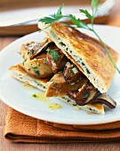Pan-fried foie gras and ceps with parsley-flavored pastry triangles